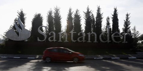 A car drives past the logo of Spanish Santander bank in a roundabout outside the company's headquarters in Boadilla del Monte, outside Madri