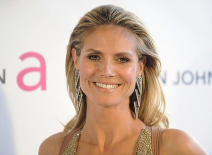 Supermodel Heidi Klum arrives at the 2013 Elton John AIDS Foundation Oscar Party in West Hollywood, California, February 24, 2013. REUTERS/G