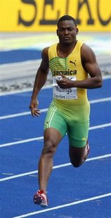 Steve Mullings of Jamaica competes in the men's 200 metres heats during the World Athletics Championships at the Olympic stadium in Berlin i