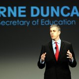 U.S. Secretary of Education Arne Duncan addresses a crowd of teachers and politicians during an event to bring physical activity back to sch