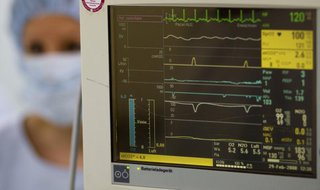 A surgery nurse is seen beside the heart beat monitor in the operating theatre of the Unfallkrankenhaus Berlin (UKB) hospital in Berlin Febr