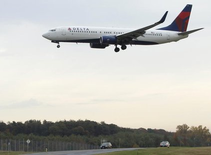 A Delta Air Lines jet lands at BWI Thurgood Marshall International Airport near Baltimore, Maryland October 24, 2012. REUTERS/Gary Cameron