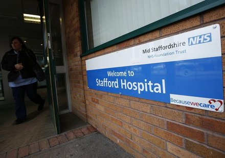 A woman leaves the Stafford Hospital in central England February 6, 2013. REUTERS/Darren Staples