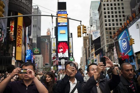 People take photos in Times Square in New York, September 29, 2012. REUTERS/Andrew Burton
