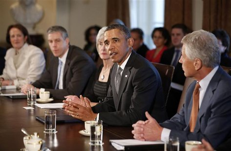 U.S. President Barack Obama participates in the first cabinet meeting of his second term in the Cabinet Room of the White House in Washingto