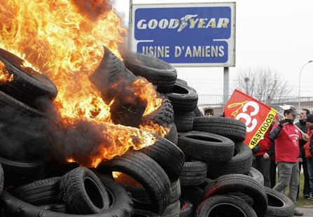 Goodyear workers burn tyres symbolizing 1,173 employees next to the Goodyear tyres factory in Amiens, February 26, 2013. REUTERS/Pascal Ross