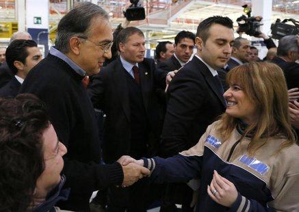 Italian car maker Fiat's Chief Executive Sergio Marchionne shakes the hands of employees during the Maserati new opening plant in Turin, Jan