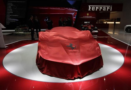 The new Ferrari car is covered on the stand during the first media day of the 83rd Geneva Car Show at the Palexpo Arena in Geneva March 5, 2