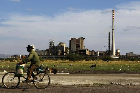 A man rides his bike past the Lonmin mine outside Rustenburg, in the northwest of Johannesburg November 9, 2012. REUTERS/Siphiwe Sibeko