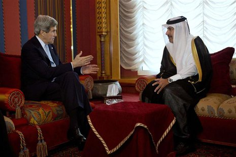 U.S. Secretary of State John Kerry (L) meets with Qatari Prime Minister and Foreign Minister Sheikh Hamad bin Jassim Al Thani at the Wajbah
