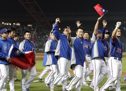 Taiwan players thank the crowd after their World Baseball Classic (WBC) qualifying first round game against South Korea in Taichung March 5,