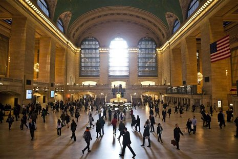Commuters pass through Grand Central Terminal in New York, in this November 12, 2012 file photo. REUTERS/Andrew Burton/Files