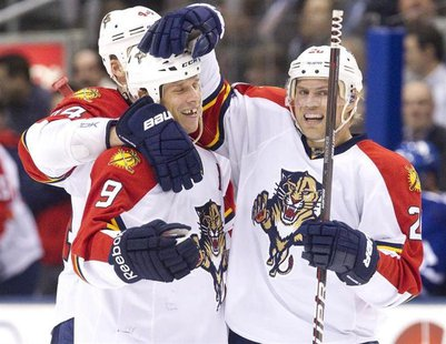 Florida Panthers Stephen Weiss (C) is congratulated by team mates Sean Bergenheim (R) and Erik Gudbranson after he scored against the Toront