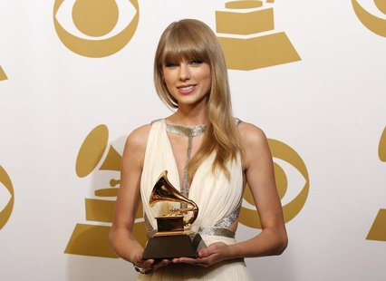 "Taylor Swift holds the award for Best Song Written For Visual Media for ""Safe & Sound"" backstage at the 55th annual Grammy Awards in Los Ang"
