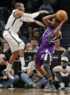 Brooklyn Nets guard C.J. Watson tries to block Sacramento Kings guard Aaron Brooks (3) in the second quarter of their NBA basketball game in