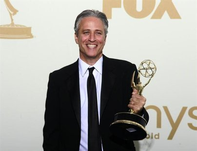 "Television host Jon Stewart holds the Emmy award for the ""The Daily Show With Jon Stewart"" after winning for outstanding variety, music or c"