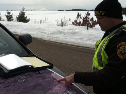 Wood County Sheriff Deputy points out the area of search efforts