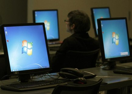Monitors running Windows are pictured at the press center of the annual news conference of Bayer in Leverkusen February 28, 2012. REUTERS/In