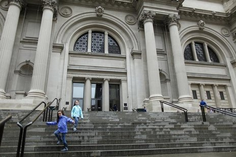 Children run down the stairs of The Metropolitan Museum of Art, in New York October 29, 2012. REUTERS/Carlo Allegri (UNITED STATES - Tags: E