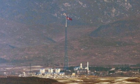 A North Korean flag on a tower flutters in the wind at a North Korean village near the truce village of Panmunjom in the demilitarized zone