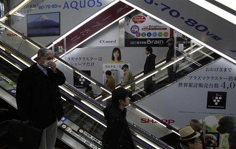 Advertisements for Sharp are seen at a train station in Tokyo March 6, 2013. Samsung Electronics Co is set to invest $110 million in Sharp C