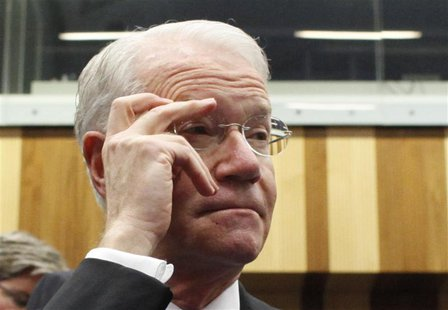 New U.S. ambassador to the International Atomic Energy Agency (IAEA) Joseph Macmanus adjusts his glasses as he attends a board of governors