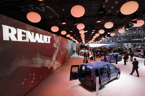 Visitors walk around the exhibition stand of Renault during the first media day of the Geneva Auto Show at the Palexpo in Geneva March 5, 20