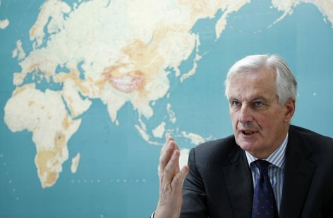 European Commissioner for Internal Market and Services Michel Barnier answers reporters' questions during an interview with Reuters at the E