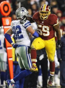 Washington Redskins linebacker London Fletcher (59) celebrates after defending a pass away from Dallas Cowboys tight end Jason Witten (82) d