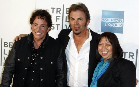 "Neal Schon (L) and Jonathan Cain of the band Journey arrive with director Ramona Diaz for the premiere of ""Don't Stop Believin': Everyman's"