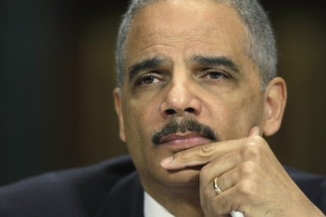 Attorney General Eric Holder listens to a question at a hearing of the Senate Judiciary Committee on Capitol Hill in Washington, March 6, 20