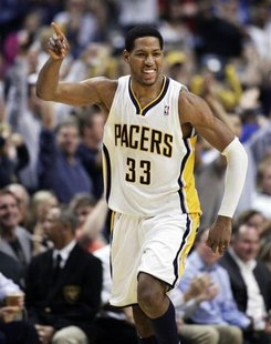 Indiana Pacers forward Danny Granger celebrates scoring against the Orlando Magic during the second quarter of Game 5 of their first round N