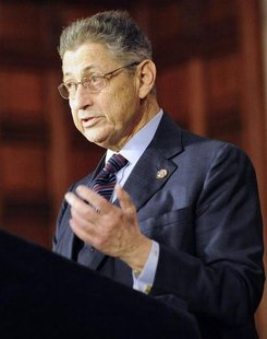 Assembly Speaker Sheldon Silver applauds New York Governor Andrew Cuomo after the New York Secure Ammunition and Firearms Enforcement Act wa