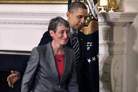 President Barack Obama leaves with Sally Jewell, CEO of Recreational Equipment Inc., his nominee for Interior Secretary, at the White House