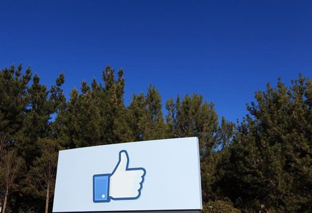 "A giant ""like"" icon made popular by Facebook is seen at the company's new headquarters in Menlo Park, California January 11, 2012. REUTERS/R"