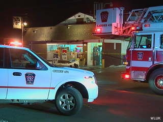 Firefighters respond to a fire at Dollar Land Inc., the former Beach Road Liquor, in Green Bay March 5, 2013. (courtesy of FOX 11).