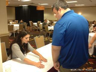 Job seekers attend an Alta Resources job fair in Neenah, Aug. 14, 2012. (courtesy of FOX 11).