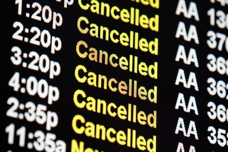 American Airlines cancellations are shown on monitors at Chicago's O'Hare International Airport.(Reuters photo)