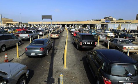 Motorists wait in lanes of traffic heading into the United States from Mexico at the U.S. border crossing in San Ysidro, California Septembe