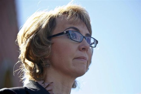 Former congresswoman Gabrielle Giffords addresses a news conference for victims of the January 8, 2011 Tucson shooting, at the Safeway groce