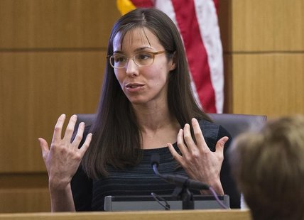 Jodi Arias gestures toward the jury in Maricopa County Superior Court in Phoenix, March 5, 2013. REUTERS/Tom Tingle/The Arizona Republic/Poo