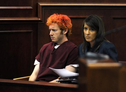 Colorado shooting suspect James Eagan Holmes (L) sits with public defender Tamara Brady during his first court appearance in Aurora, Colorad