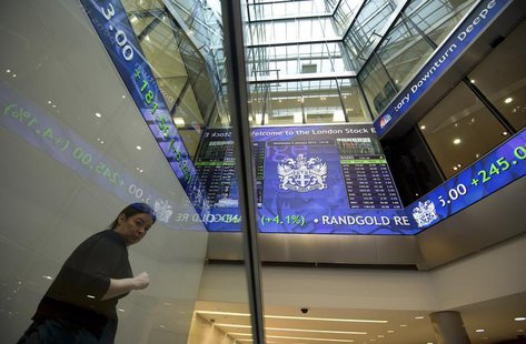 Electronic information boards display market information at the London Stock Exchange in the City of London January 2, 2013. REUTERS/Paul Ha