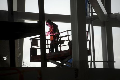A worker welds a support at Santa Clara Stadium, the future home of the NFL's San Francisco 49'ers, in Santa Clara, California March 6, 2013