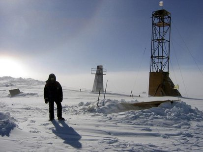 A man stands near drilling apparatus at the Vostock research camp in Antarctica in this January 13, 2006 handout photograph. REUTERS/Alexey