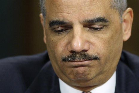 U.S. Attorney General Eric Holder pauses during testimony before the Senate Judiciary Committee on Capitol Hill in Washington, March 6, 2013
