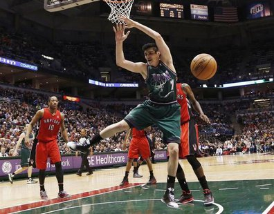 Milwaukee Bucks forward Ersan Ilyasova loses the ball as he drives to the basket against the Toronto Raptors during the second half of their