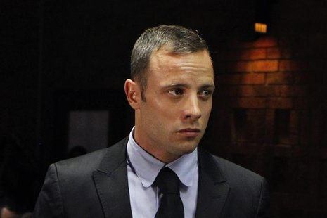 """Blade Runner"" Oscar Pistorius stands in the dock during a break in court proceedings at the Pretoria Magistrates court February 20, 2013. R"
