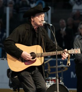 "Canadian singing legend Stompin' Tom Connors sings ""The Hockey Song"" before the start of the NHL game between the Toronto Maple Leafs and th"