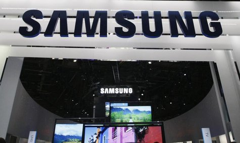 New televisions are displayed at the Samsung booth on the first day of the Consumer Electronics Show (CES) in Las Vegas January 8, 2013. REU